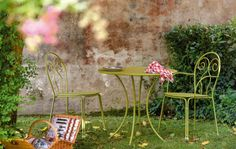 This is the Caprera Outdoor Armchair in green steel from IQ Furniture.