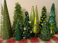 My green Christmas tree collection is my dining room center piece this year.  Always on the look out for another tree.