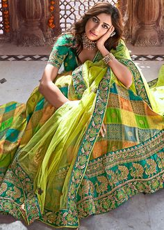 Indian designer green lehenga choli for wedding outfits For order whatsapp us on wedding outfits wedding dress wedding dresses lengha lehnga sabyasachi manish malhotra Party Wear Indian Dresses, Indian Bridal Outfits, Dress Indian Style, Half Saree Designs, Lehenga Designs, Stylish Dress Designs, Stylish Dresses, Designer Bridal Lehenga, Bridal Dupatta