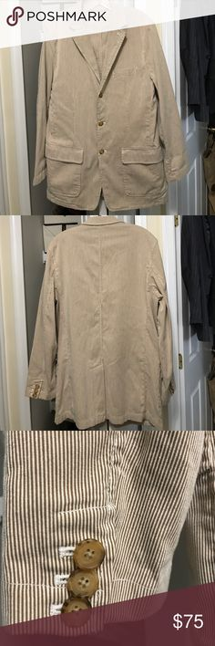 100% cotton J Crew Unlined summer Sport Coat!! This a a J Crew summer sport coat. Made of 100% cotton. The color is a tan base with cream colored corduroy lines. The inside seams of the arms are welded for comfort and durability. This is a size Medium. It fits like a 40-42 regular. The sleeves have working buttons so you can tell the quality. Also they can be rolled up for style without damaging cuff.  It is a 3 button with 5 pockets. 2 inside and 3 out. It's a great jacket. It can be washed…