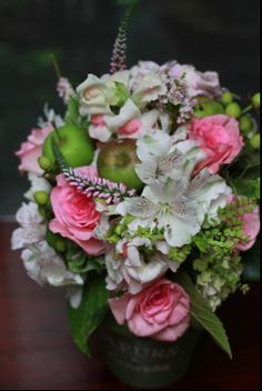Small Green Apple, Alstromeria, Roses, Silver Suede, Hypericum Berries feature in this rustic wedding bouquet