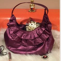 Metallic purple hobo style shoulder bag Metallic faux purple hobo inspired shoulder bag.  Front has ruffles interior has a lighter violet purple lining.  Brand new condition,  never been used‼️✌️. Size is approximately 16 x 11.5.  Shoulder drop is approximately 12 inches.❤️ Bags Shoulder Bags