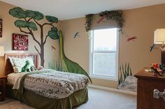 This dinosaur themed kid's bedroom is one for the ages! Add extra detail by painting scenery on the walls! | Fischer Homes