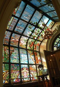 Stained glass in hallway of parliament building, Vienna, Austria.