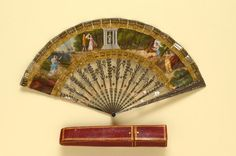 Cut steel fan (c1810) depicting Diana's Temple, with original leather & cardboard box. The Fan Museum