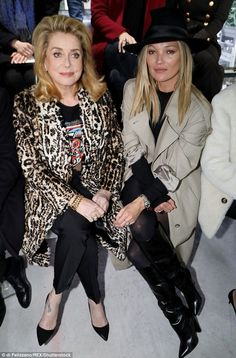 Fashion pals: She took pride of place in the front row with French actress Catherine Deneu...