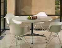 Mom is insisting on these Eames Dining Chairs by Herman Miller (with a tulip table). They're definitely growing on me.