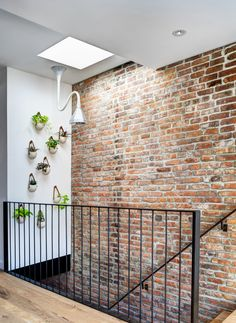 Dream Houses: Gorgeous Wall Planters Next To The Staircase With Skylight Above - Brooklyn Home with Brick Walls Gets a Modern Renovation Railing Design, Staircase Design, Interior Stairs, Interior And Exterior, Staircase Railings, Banisters, Staircases, Exposed Brick Walls, Fake Brick Wall