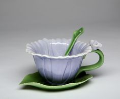 Make each day special with this lovely teacup and saucer set.  The Purple Dahlia  Set comes with flowers shaped teacups, leaf shaped saucers and a matching spoons. This a wonderful treat for yourself or a perfect gift for a friend. This Product Features: 2 ceramic flower shaped cups size: 5″ x 4″ x 2 3/4″H 2 matching …