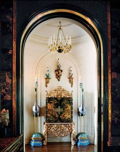 A chandelier reputedly owned by Josephine Bonaparte hangs above a William III cabinet and Chinese cloisonné cranes in the Getty's SF home.