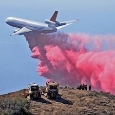 """""""An air tanker drops retardant on the Gibraltar Fire, as firefighters watch from a peak in Los Padres National Forest above Santa Barbara, California in…"""""""