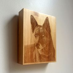 Small Saints uniquely designed custom portrait urn/keepsake vessel.  Small Saints laser-engraves an image of your pet onto the surface of a beautiful, locally hand-crafted urn.  You place whatever you wish inside the compartment, accessible via the back. It hangs on your wall just like a precious portrait should!