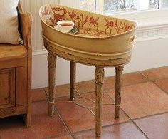 Old tin tub on table for side table - paint and stencil interior or wallpaper it for interest. Best part is that the cat can't easily clear the table when he inevitably jumps up onto it!