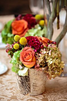 Birch vases with an autumnal color palette.