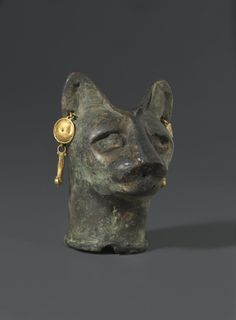 Cat's Head. From Egypt. Roman Period, 30 B.C.E.–third century C.E. Bronze, gold, 23⁄8 x 13⁄4 x 113⁄16 in. (6 × 4.4 × 4.6 cm). Brooklyn Museum, Charles Edwin Wilbour Fund, 36.114