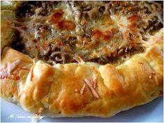 recette toute simple de tarte salée à la viande hachee bien délicieuse et trés rapide à préparer avec une pâte feuilletée. cette tarte est très parfumée