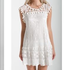 White lace dress with pompoms White lace dress with pompoms. Sleeve. Size small. New sample with tags. Also available in all black. Dresses Mini
