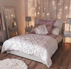 the fairy lights behind whimsical sheer curtains will serve dual purposes - broadening my tiny Manhattan bedroom and providing an inexpensive headboard. MUST HAVE.