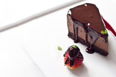 You can make this triple #chocolate #cheesecake without even turning on your oven! Garnished with a rich chocolate sauce and Florida #strawberries, it's absolutely irresistible! Minimal effort, maximum flavor.