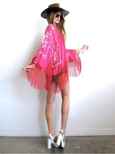 Insanely gorgeous one-of-a-kind HOT PINK! silk fringed kimono!! Vintage inspired using a crepe de chine silk spanish shawl in the most stunning shade of hot pink and contrasting ivory hand embroidery all over. Silk fishnet fringe adds extra magic to this beauty! So many ways to wear and style this loveliness, truly effortless and timeless!Color is appearing a little more neon than it actually is so I've added a color swatch on 2nd photo.Loose fit will fit a good range of sizes...
