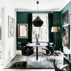 Dark green walls, Mid Century furniture, and a Tom Dixon Beat Stout Pendant Lamp equals impossible glamour.