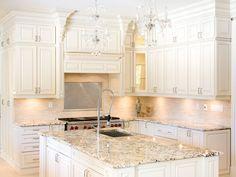 White kitchen.. white kitchen cabinets, crystal chandeliers, kitchen idea, kitchen countertops, kitchen paint colors, light, granite countertops, white cabinets, white kitchens