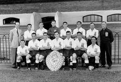 1949. The Fulham team pose at Craven Cottage with theirSecond Division Championship trophy
