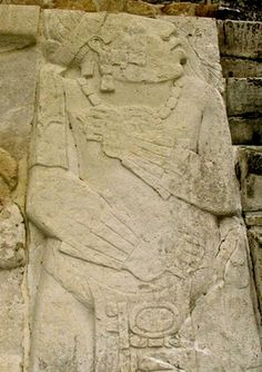 A captive in a typically submissive pose. Looking fearfully up at the place where his captors and executioners glory in their victory, the captive stands with one arm across his ches,and one across his belly.This may have been the remains of his armor,or possibly jade bracelets Palenque Chiapas Mexico