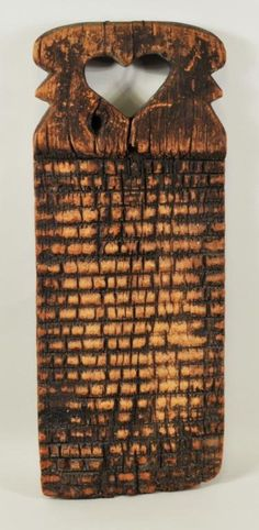 Carved wooden washing board.