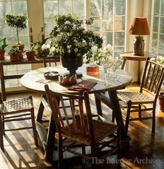 Light pours into this breakfast room surrounded as it is by walls of floor to ceiling windows ~ Bill Blass in CT