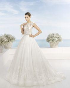 Vestido de encaje pedreria y tul en color natural. Vestido de encaje pedreria y tul en color blanco.