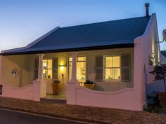 The Vishuis - The Vishuis is a charming fisherman's cottage, situated in the heart of the old village just above The Old Harbor, in the centre of Hermanus. The guest house comprises of three suites and the luxurious . Cafe Design, House Design, Cottage Plan, Garden Cottage, Fishermans Cottage, African House, Pack Up And Go, Country Hotel, Elegant Homes