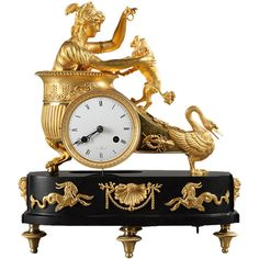 French Empire mantel clock in ormolu and black marble base, ca 1800