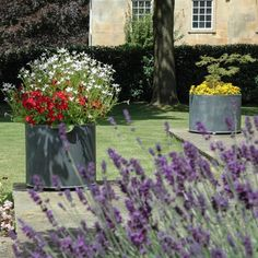 Large Garden Planters to enhance your garden - Beautiful Summer flowers in circular metal planters make a stunning addition to any garden. Large Garden Planters, Backyard Planters, Garden Planter Boxes, Stone Planters, Zinc Planters, Patio, Small Space Gardening, Small Gardens, Garden Spaces
