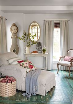 A friend of the owner's sewed the linen slipcover for the sitting room's chaise lounge in this  Arkansas home, purchased new at nearby boutique Vintage Cargo. The curtains are from Pottery Barn.   - CountryLiving.com
