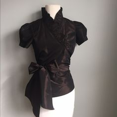 Zara Brown Taffeta Wrap Top w/ Ruffle Collar; Sz M This is a gorgeous and unique top from Zara--deep chocolate brown taffeta with a wrap around design and a thick sash at waist. Love this with a pencil skirt or even a ball skirt for more formal holiday parties Zara Tops Blouses