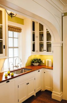 Crown Point Cabinetry - Period Homes Backsplash With Dark Cabinets, Glass Front Cabinets, Wood Countertops, White Cabinets, Yellow Kitchen Cupboards, Yellow Kitchens, Kitchen Yellow, Hexagon Backsplash, Travertine Backsplash