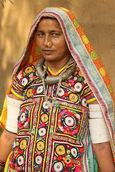 Meghwal tribal woman (Gujarat). The people of Meghwal tribe are originally from Marwar in Rajasthan. These days they are also found living in western Gujarat near the Pakistan border. In Pakistan, Meghwals mostly live in Tharparker, Badin, Mirpurkhas, and Umerkot districts while in Southern Punjab. Marwar is the region of Rajasthan in India that lies in Thar Desert. They live in small hamlets of round, mud-brick huts painted on the outside with colourful geometric designs and decorated wi...