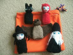 5 beautiful hand knitted finger puppets perfect for little fingers at Halloween.    Set contains a Witch, a Wizard, a Devil, a Bat and a Cat