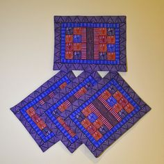 """Multi-Colored Mini Elephants Placemats"" Zimbabwe Textiles. Setof4Placemats Theseplacematsarecleverlydesignedusingrepeatdesigns. TheseplacematsarehandprintedbyZimbabweanwomenwhoworkfromhome. TheirwaresarethensoldattheAvondaleMarketinHarare."