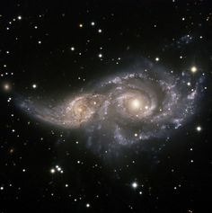 This picture is in Public Domain. ngc 2207, spiral galaxy, light year