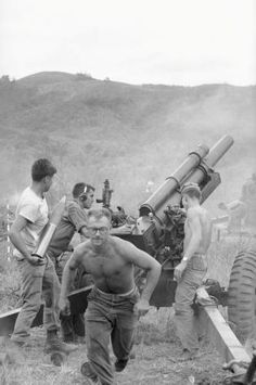 U.S. Marine artillery crew load and fire their 105mm gun toward suspected North Viet Namese position in hills just south of the demilitarized zone between North and South Viet Nam on July 30, 1966. Marines are on Operation Hastings, a lengthy mission against communist troops infiltrated through the neutral zone. This unit is with the 2nd Battalion, 1st Marines, near Dong Ha. Series of negatives shows crew sighting, loading, and aligning their 155. AP Photo/Dv Phuoc)