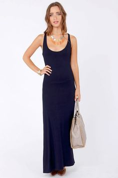 Check it out from Lulus.com! Bring a little love into your life with the Lucy Love Racer Back Navy Blue Maxi Dress and let your beachy beauty shine through! Super soft knit in an enchanting shade of navy blue has a racer back and tank straps, plus a sultry scoop neck. An on-trend maxi-length hem can be customized for any occasion. Lined to mid thigh. Model is wearing a size small. 95�0Rayon, 5�0Spandex. Hand Wash Cold. Made with Love in the U.S.A.