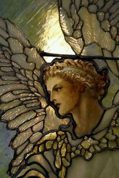 Angel detail from , probably, a Tiffany Studios window. Though it might very well be the work of John LaFarge, from whom Tiffany co-opted the style.