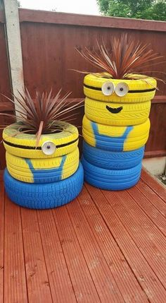 """Minion planters made from old tires. More """"Minion planters"""" Garden Crafts, Garden Projects, Garden Ideas, Easy Garden, Fence Ideas, Garden Tips, Tire Craft, Painted Tires, Tire Furniture"""