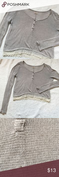 Lace Hem Shirt Super cute! Cropped length (21 inches from shoulder to hem in back, and 20.5 in front). Good condition: no holes in lace, one small snag under buttons in front (like it's really small) and a light stain on the top/back of the left arm. Hollister Tops Tees - Long Sleeve