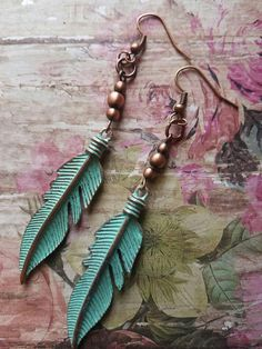 Check out these earrings in my Etsy shop https://www.etsy.com/listing/523750271/patina-leaf-earrings-cooper-dangle