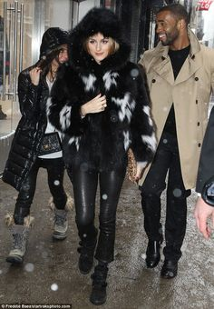Furry girl: Olivia Palermo was spotted leaving a Banana Republic store in New York City wearing a black and white fur coat
