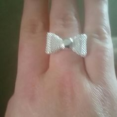 New silver plated bow ring New silver plated bow ring adjustable 2 available price is for 1 Jewelry Rings