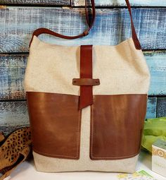Linen bag pockets and leather strap. A large tote bag is made